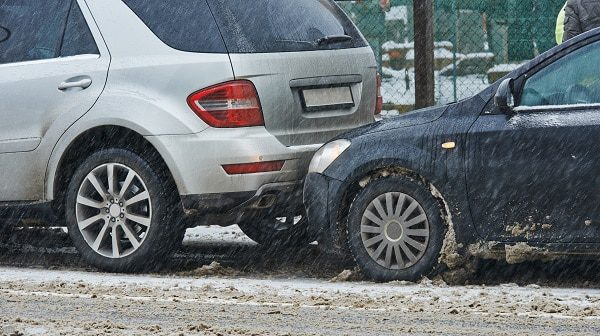 Unable to stop on the icy road, a driver rear-ends an SUV