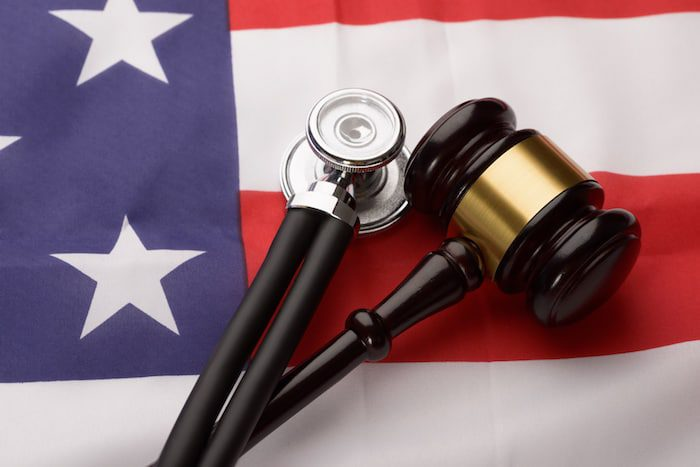 Wooden Gavel And Stethoscope an American Flag