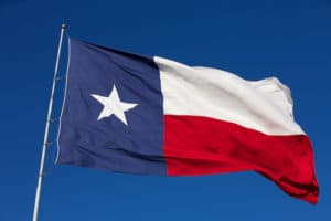The State Flag of Texas flies in the wind
