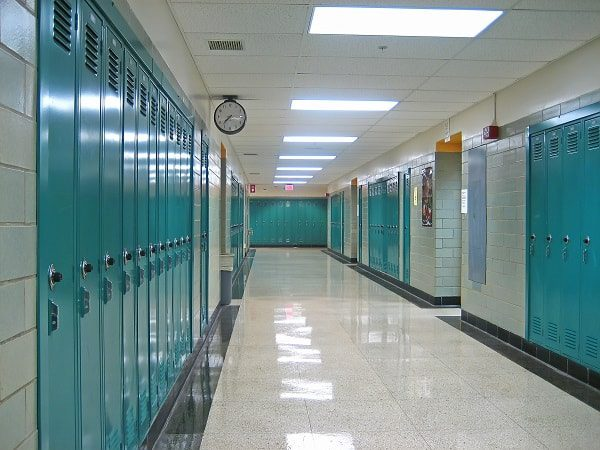 Lockers line an Empty Hallway in a Public School