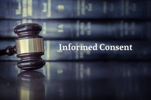 """A gavel with a stack of legal books in the background, beside the words """"Informed Consent"""""""