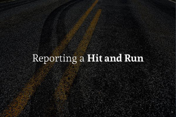 "Closeup of a road with skid marks and the words ""Reporting a Hit and Run"""