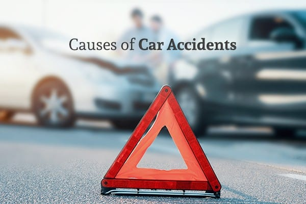 "An orange caution triangle with a car wreck in the background and the words ""Causes of Car Accidents"""
