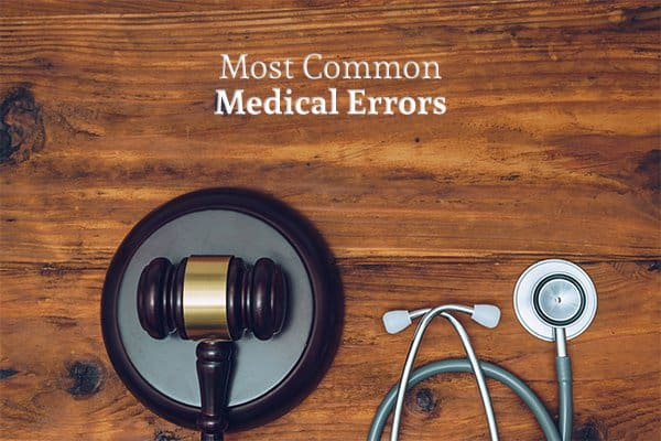 A gavel beside a stethoscope on a desk under the words most common medical errors