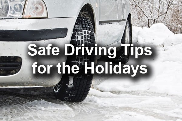 A car sliding on ice with the words, safe driving for the holidays.