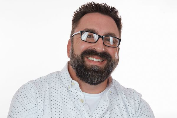 Professional headshot of claims manager Ricky Stephens