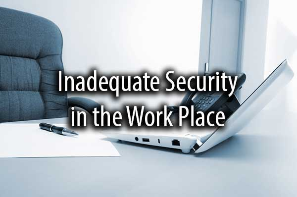 An office desk with the words, inadequate security in the work place.