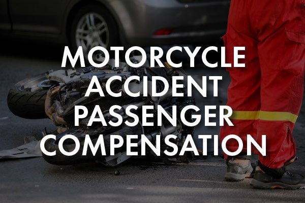 """A motorcycle crash with the words, """"motorcycle accident passenger compensation."""""""