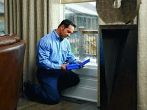 A Technician tests a floor vent in a home