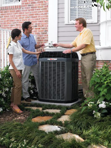 A couple talks to their AC Repairman