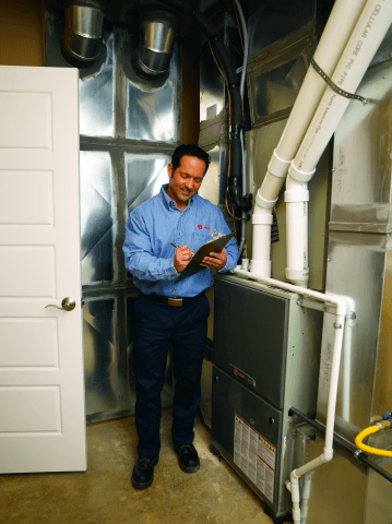 A tech checks a heater maintenance task off his list