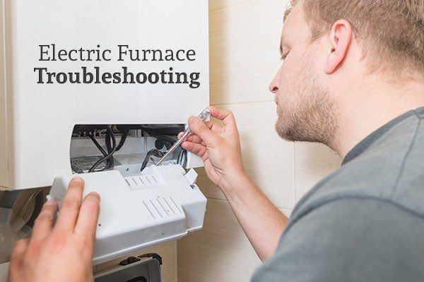 "A man fixing an electric furnace with the words ""Electric Furnace Troubleshooting"""