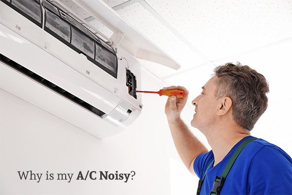 Man fixing an air conditioning unit with a screwdriver, with the words, why is my A/C noisy.