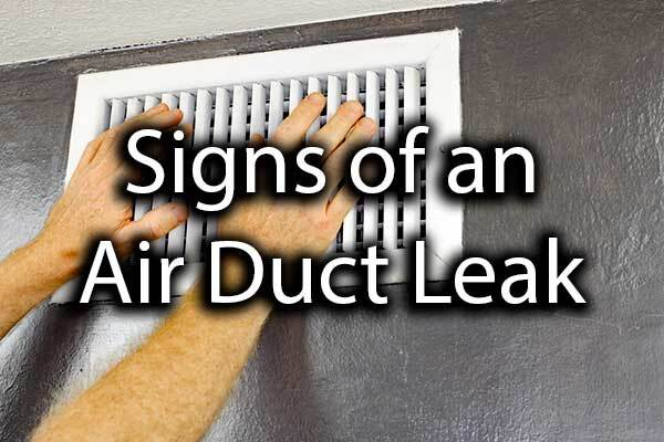 "A person feeling for air in their air duct with the words, ""signs of an air duct leak."""