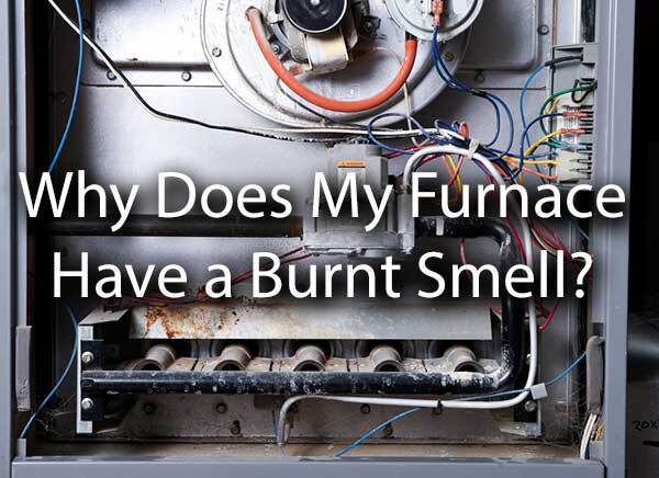 "An old furnace with the words, ""Why Does My Furnace Have a Burnt Smell?"""