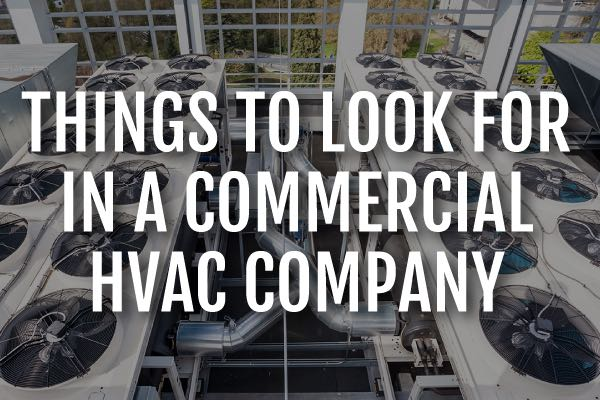 "A commercial air conditioning unit with the words, ""things to look for in a commercial HVAC comany."""