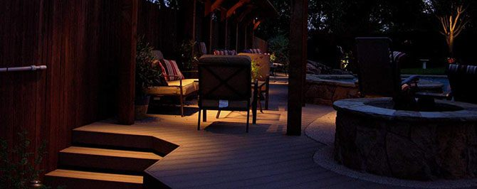 Lights installed around a patio set the poolside mood