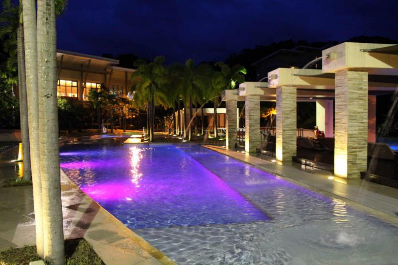 Colorful Poolside lighting add to the beauty of a modern swimming pool