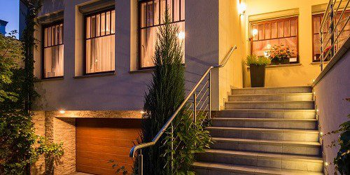 Lighting highlights the curb appeal of a modern home