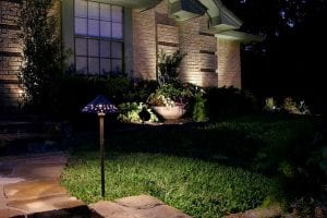 An LED lights the pathway leading to a house