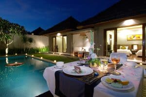 A family dinner by poolside is set in the perfect light