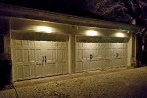 Security Lighting shines on a Three car garage at night