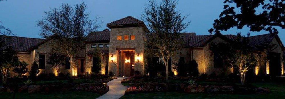 A Large single-story home is protected by security lighting