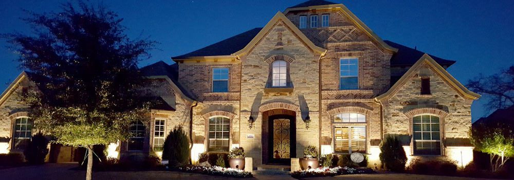 Accented by new LED lighting, a beautiful home is visible at night