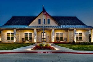 Front view of a well-lit senior living center