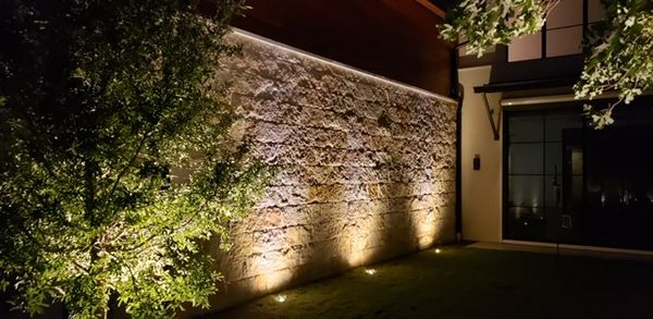 Outdoor lighting of a beautiful stone wall