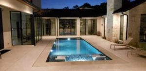 Backyard pool lighting in a courtyard