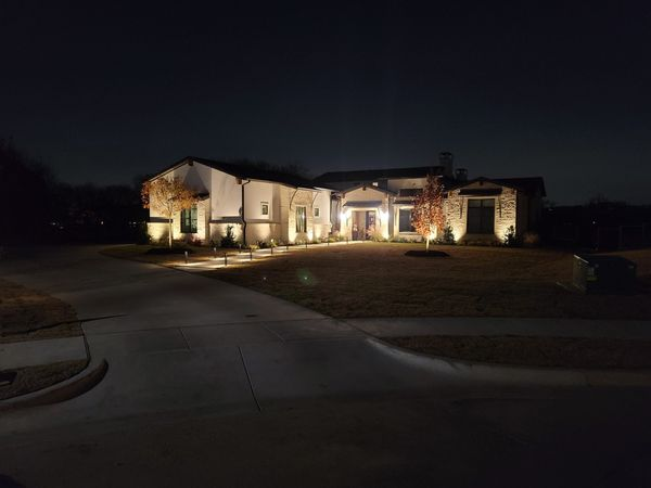outdoor lighting on a beautiful white house
