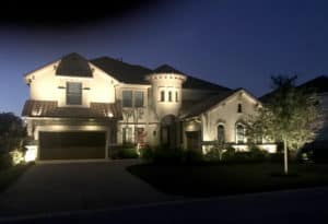 A home's exterior enhanced by well designed outdoor lighting