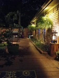 A patio at night lit up by LEDs