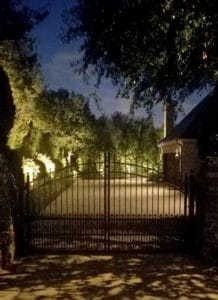 Security Lighting illuminates the entry points of an upscale home