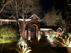outdoor lighting on a pathway leading to a front door