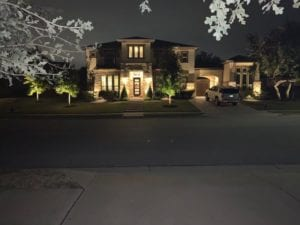 outdoor lighting shining on a home