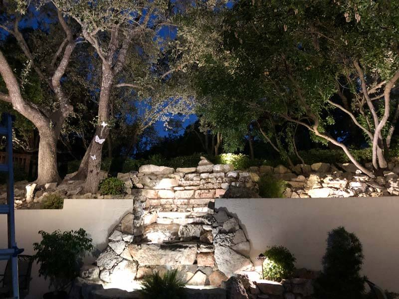 Gorgeous outdoor lighting highlighting a garden.