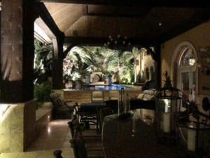 outdoor lighting around a pool and under patio