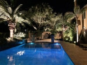 poolside lighting and landscape lighting in a beautiful backyard