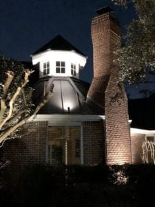 a light pointed to the top of a house