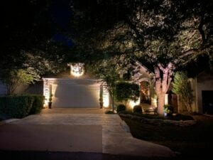 landscape lighting of a small brick home