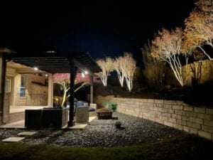back patio and pergola with outdoor lighting