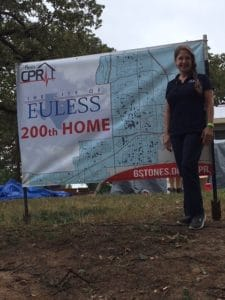 Kathlyn Smith next to Euless 200th Home sign