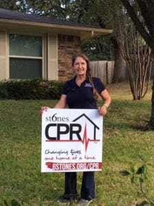 Kathlyn Smith holding yard sign for 6 Stones CPR