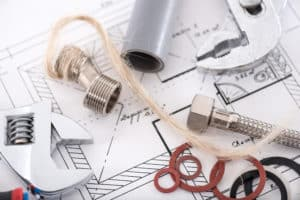 Pipe fittings and wrenches on blueprints