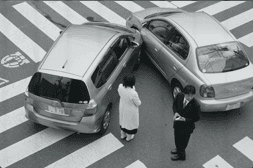 drivers exchange insurance information at the scene of an accident
