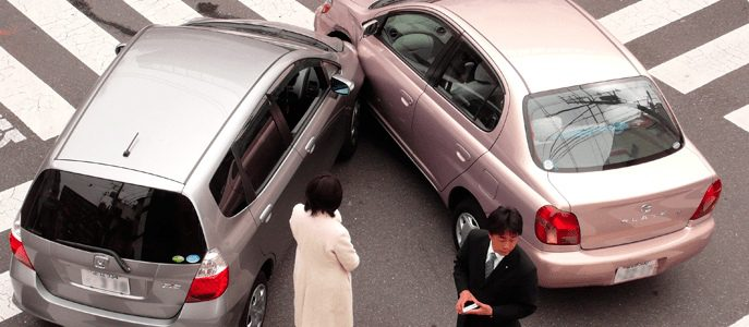 After a car accident. drivers exchange insurance information