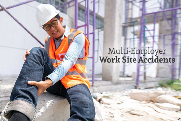 "A man on a construction site wearing an orange reflective vest and a hard hat sits holding his leg, grimacing in pain beside the words ""Multi-Employer Work Site Accidents"""