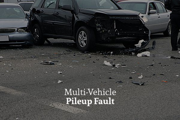 Three cars crashed into each other on the road with the words multi vehicle pileup fault